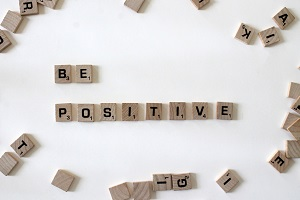 Wooden tiles arranged to spell Be Positive